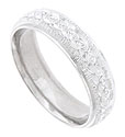 The center of this 14K white gold mens wedding band is covered with a surface of deeply carved lines embellished with jewel engraved abstract florals