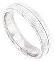 A bright polished channel is carved down the center of this florentine finished mens wedding band