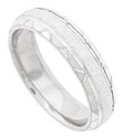 The satin finished central band of this 14K white gold mens wedding ring is flanked by a pattern of jewel cut triangles