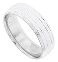 Multiple carved bright channels encircle the face of this pebble finished antique style mens wedding band