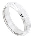 The center of this 14K white gold mens wedding band features a pebble finish carved with simple lines