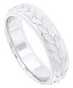 A central pattern of large, richly carved leaves winds across the face of this 14K white gold mens wedding band