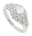 A luminous .40 carat, G color, Si1 clarity round diamond graces the center of this 14K white gold antique style engagement ring