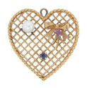 This heart shaped 14K yellow gold vintage charm features a lattice pattern as a backdrop and is set with a ruby, a sapphire and a pearl