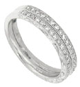 The sides of these 14K white gold wedding rings are hand engraved with looping designs