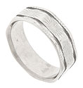 This unusual 14K white gold estate wedding band features an octagonal shape with softened edges