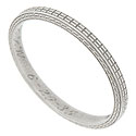 A simple repeating linear pattern on the face of this 18K white gold estate wedding band gives this ring its classical appeal