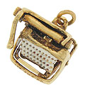 This remarkable 14K yellow gold typewriter charm features a moving space bar and carriage return lever