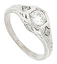 A brilliant .46 carat G color, Vs2 clarity round diamond is set into the face of this elegant antique style engagement ring