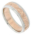 This 14K white gold mens wedding band is embellished with an organic pink gold decoration