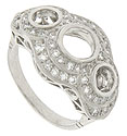 Rings of round faceted diamonds blanket the face of this fabulous platinum antique style engagement ring mounting