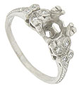 A diamond studded filigree decorates the shoulders of this antique style platinum engagement ring mounting
