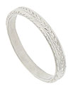 This beautiful antique style platinum wedding band is crafted from the original antique wedding band