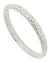 This finely engraved antique style wedding ring is crafted of platinum from the original antique ring