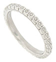 A circle of posies dance across the surface of this platinum antique style wedding band