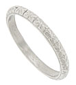 Richly engraved flowers encircle the face of this antique style platinum wedding band