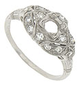This sparkling platinum antique style engagement ring mounting will hold a .35 carat round stone