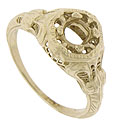Organic engraving and delicate filigree covers the surface of this 18K yellow gold engagement ring mounting