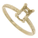 This 14K yellow gold antique style engagement ring mounting is crafted with a deep octagonal shank that will hold a 7 x 5 emerald cut stone