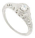 A filigree of twisting leaves covers the shoulders and sides of this 14K white gold engagement ring mounting