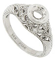 This glittering 14K engagement ring mounting is decorated with an eleborate pattern of curling leaves and florals