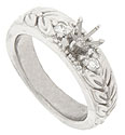 The wide band of this 14K white gold engagement ring mounting is engraved with large detailed leaves and berries