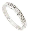 This classically designed wedding band is crafted of 14K white gold and frosted with .06 carats of fine faceted diamonds