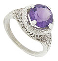 A richly hued 9.18 mm round amethyst stone is set in this beautifully detailed floral filigree ring