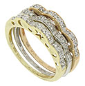 A trio of diamond encrusted wedding bands sparkles in 14K white, yellow and rose gold