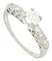 This radiant engagement ring features a sparkling .50 carat, H color, Si1 clarity round diamond