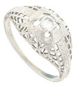 Intricate engraving and floral filigree adorn the shoulders and sides of this wonderful vintage engagement ring