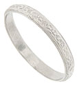 This spectacular platinum antique style wedding band is fashioned from the original antique ring