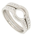 Organic engraving adorns the shoulders and sides of these 14K white gold antique style curved wedding bands