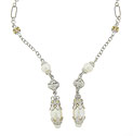 This lovely antique style necklace is fashioned of sterling silver and detailed with 14K yellow gold beads and pearls
