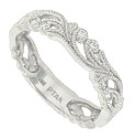 Lacy ferns cover three quarters of this 14K white gold antique style floral wedding band