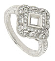 This platinum antique style mounting features a square face and scalloped ribbon edge frosted in fine faceted diamonds