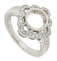 This platinum antique style engagement ring mounting is designed to hold a 2.0 carat round center stone