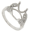 Diamond encrusted three dimensional leaves sprout from the sides of this platinum engagement ring mounting