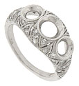 A repeating pattern of triangular filigree covers the face and shoulders of this fantastic engagement ring mounting