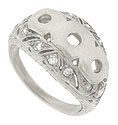 Abstract organic filigree set with sparkling diamonds surrounds the central mounts of this platinum engagement ring mounting