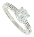 Each shoulder of this 14K white gold engagement ring mounting is set with diamonds