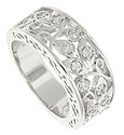 Curling vines of diamond encrusted leaves spring from the edges of this spectacular 14K white gold wedding band