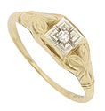 This floral inspired vintage engagement ring is fashioned of 14K yellow gold and engraved with large petaled leaves