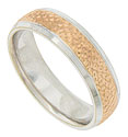 This distinctive 14K bi-color mens wedding band features a central band of pebble engraved rose gold flanked by white gold impressed edges