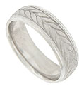 A vine of matte finished leaves encircles the face of this 14K white gold mens wedding band