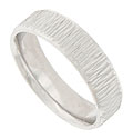This 14K white gold mens wedding band is covered with a pattern of rough hewn engraving