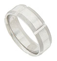 The center of this 14K white gold mens wedding band is polished smooth and engraved with deeply engraved channels at wide intervals