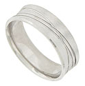 This curved, satin finished mens wedding band is crafted of 14K white gold and engraved with orbiting lines