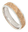 Engraved paisleys crafted of 14K rose gold cover the face of this antique style mens wedding band