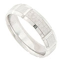 This 14K white gold mens wedding band features a hand hammered surface engraved with deep carved ridges
